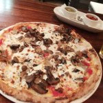 Boscaiola Pizza (tomato sauce, fresh mozzarella, mushrooms, fennel sausage)
