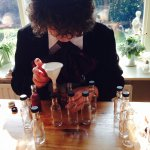 Mad Hatter preparing the Drink Me Drinks
