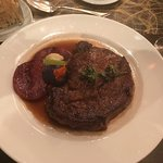 Grilled ribeye, medium rare with grilled melon.