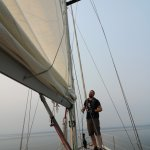 Kyle Setting the main sail.