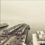Classic foggy morning off of the harbor in Boston from the Presidential Suite.