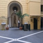 Courtyard entrance to building with Hotel Fontanella Borghese.