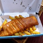 A generous golden brown beer battered cod with chips for lunch