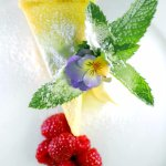 Citrussy lemon tart served with lavender ice cream, creme fraiche and raspberries.