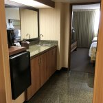 Microwave/fridge/wet bar/coffee maker area