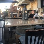 Outdoor seating and sundeck at Milano's Italian Restaurant at the Ventura Harbor.