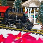 The train weaving through the model village in the atrium during Christmas at Garfield