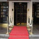 Red carpet entryway to revolving door