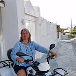 Susan on her quad out front of Hotel Milena