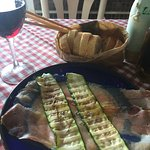 The house special starter, zucchini and prosciutto with LOTS of baked provolone cheese.