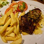 300g sirloin steak with fries and half the tomato salad