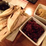 Hummus republic style, red quinoa, beet and Moroccan spices, and pita