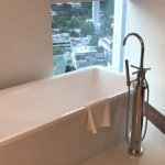 Stand alone tub, with view over city