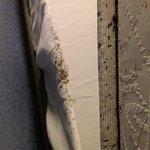 Under headboard and between mattress and dust ruffle