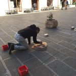 Chalk artist in the piazza.