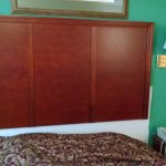 Why hang a new headboard with out repainting where the old headboard was removed.?
