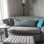 couch & ottoman; attractive but not very comfortable, not modern lamp