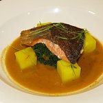 Sea trout with curried shellfish broth, kale, saffron potatoes