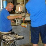 The artisans on Murano demonstrate the precise art of making a pitcher with molten glass for us.