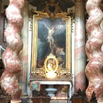 Marble column and crusifixion painting