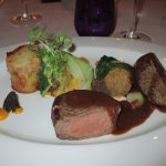 Grilled fillet of Angus beef with slow cooked sticky rib, oxtail bon bon, tartiflette potato and