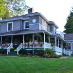 Front of B&B with large wrap around porch.