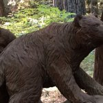 Interesting wood carved animals line the drive