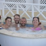 Hot tub in room 210 with the bride, groom, best man and his wife before the wedding.