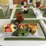 Lobster quiche mixed fresh salad fruit and coffee