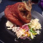 Pork knuckle with sauerkraut and apple sauce