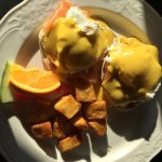 Poached eggs with salmon and potatoes