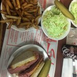 Montreal smoked meat sandwich, pickle, fries and coleslaw meal