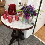 Marble top table & red brandy snifter & matching glasses