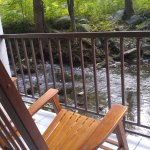 "Relax on the ""back porch"" listening to the babbling brook as you rock into serenity!"