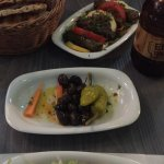 Grilled halloumi and stuffed vine leaves, with complimentary olives carrots and peppers
