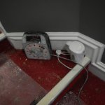 Workman's Kettle in hall way, lead sticking out over steps! Trip hazard!