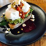 Smashed avo and poached eggs on sourdough with tomato relish, bee Troon purée and feta.