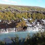Hraunfossar is a series of waterfalls on a lava field.