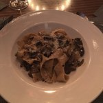 All quite delicious. Antipasto plate and calamari. Mushrooms papardelle and seafood pasta.