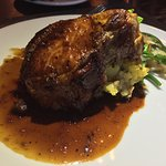 Roasted Haanover view farms pork chop   sage, roasted squash & bacon bread pudding   crab apple