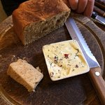 Warm bread with olive herb butter