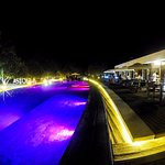 Pool and restaurant at night