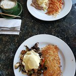 Eggs Benny with ham and Veggie Benny, both with hashbrowns