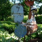 Rooster sculpture from farm implements greeting guests at the driveway