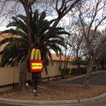 McDonalds drive through runs along the side of the motel