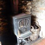 Fireplace in sitting room at Teach Ceann Tui