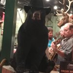 Musicians behind the bear.