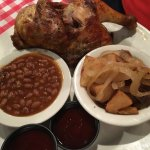 Baked chicken, baked beans, home fried potatoes