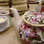 Pot of tea and cream and jam for scones