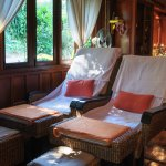 Foot massage awaits, in the cozy Thai wooden house